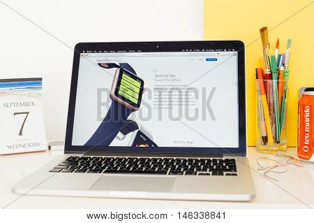 PARIS FRANCE - SEP 8 2016: Apple Computers website on MacBook Pro Retina in a geek creative room environment showcasing new Apple Watch Series 2 with workout app
