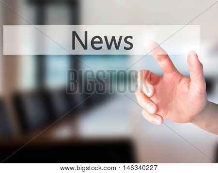 News - Hand Pressing A Button On Blurred Background Concept On Visual Screen.