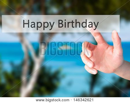 Happy Birthday - Hand Pressing A Button On Blurred Background Concept On Visual Screen.