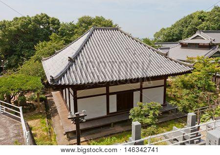 MATSUYAMA JAPAN - JULY 22 2016: Main Hall (Hondo circa 13th c.) of Taihoji Temple in Matsuyama Ehime Prefecture. National Treasure of Japan