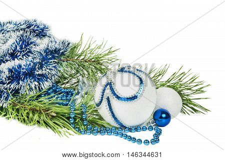 Christmas tree branch and blue ball with white glitter isolated