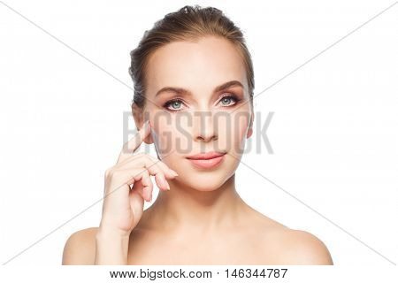 beauty, people and plastic surgery concept - beautiful young woman showing her cheekbone over white background