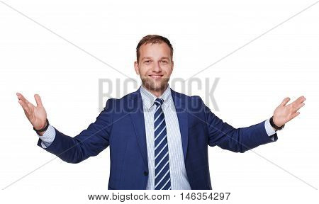 Young happy succesful businessman with open hands isolated on white. Portrait of a confident guy in trendy blue suit looking at camera and smiling