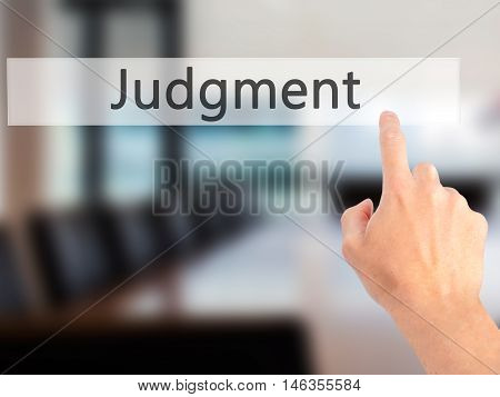 Judgment - Hand Pressing A Button On Blurred Background Concept On Visual Screen.