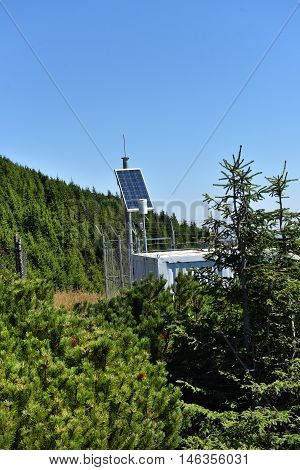 Photovoltaic Panel Installation In Remote Mountain Range Used To Power The Meteorological Station