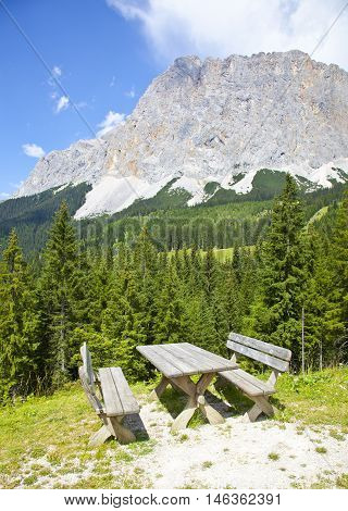 View at picknick table near Ehrwalder Almsee with mountain landscape Tirol Austria