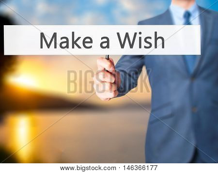 Make A Wish - Businessman Hand Holding Sign