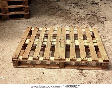 Wooden Pallet On Worn Out Concrete Ground. Empty Pallet