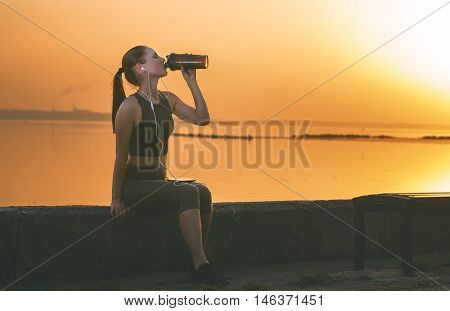 Young Girl With A Shaker Water Outdoors