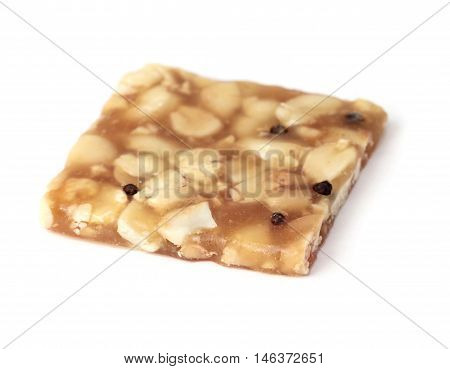 Indian sweet brittle bar isolated over white
