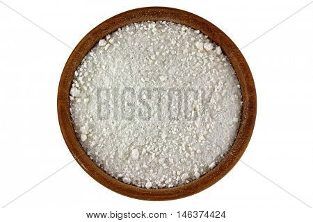 Top view of natural and unpolluted crystal salt from the Mountain in Europe in a wooden bowl isolated on white background