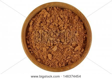 Top view of Cocoa powder in brown color in a wooden bowl isolated on white background
