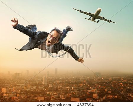 business man flying from passenger plane flying over sky scraper