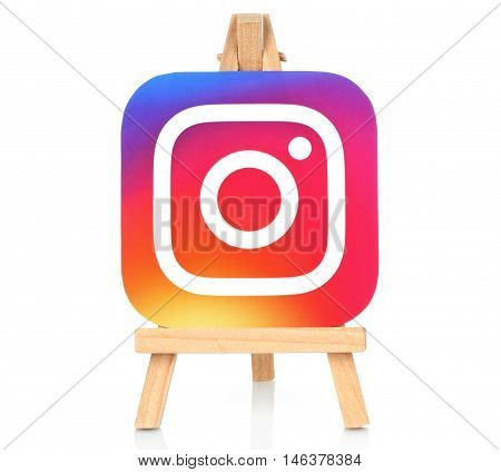 Kiev Ukraine - August 30 2016: Instagram icon printed on paper and placed on wooden easel. Instagram is an online mobile photo-sharing video-sharing service