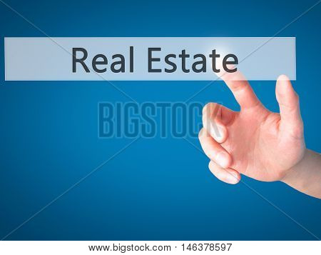 Real Estate - Hand Pressing A Button On Blurred Background Concept On Visual Screen.