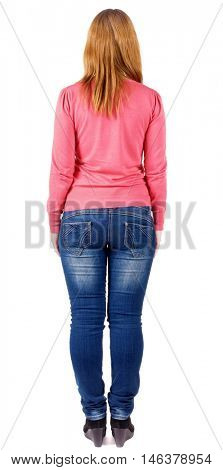 back view of standing beautiful brunette woman . Young girl in jeans and a sweater .  Rear view people collection.  Isolated over white background.  backside view of person.  Isolated over white