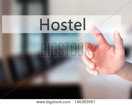 Hostel - Hand Pressing A Button On Blurred Background Concept On Visual Screen.