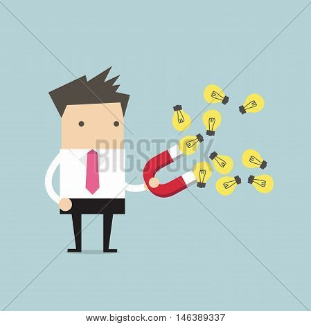 Businessman with horseshoe magnet collecting light bulb
