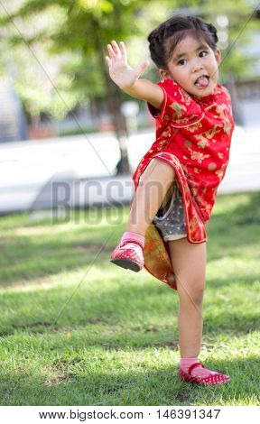 Asian Girl Action Like Thai Chi Kungfu In Park