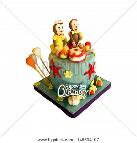 Colorful birthday celebration cake decorated with animal figures for kids party