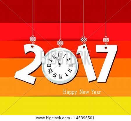 Happy new year 2017 clock. Colorful design with reds, oranges, and yellow background.