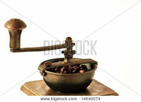 Old Coffee Grinder With Coffee Grains - Close Up
