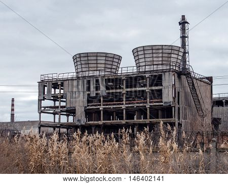 Abandoned cooling tower. Old rusty cooling tower. Industrial zone. Ukraine