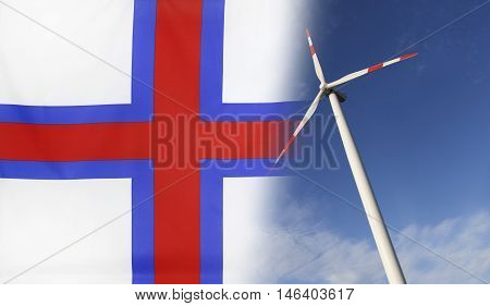 Concept clean energy with flag of Faroe Islands merged with wind turbine in a blue sunny sky
