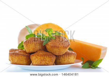 Sweet pumpkin muffins on a white background