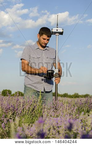 Geodesy measurement in a lavender field in countryside