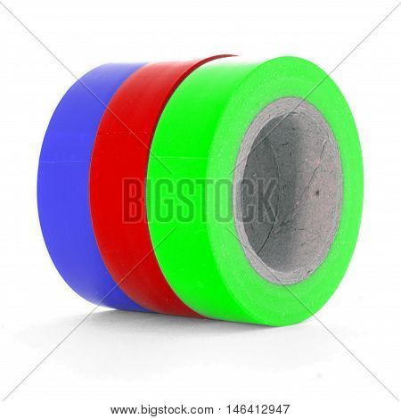 Blue red green insulating tape reels isolated on white background