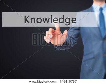 Knowledge -  Businessman Press On Digital Screen.
