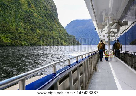 Father With Daughter Walking On The Deck Of Touring Boat. New Zealand