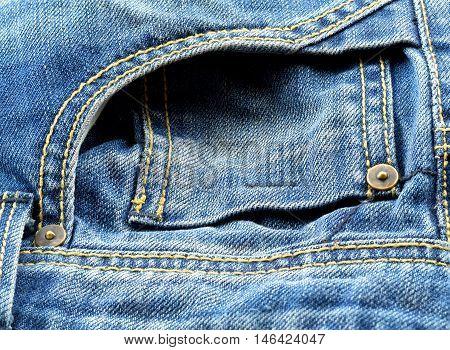 Denim jeans texture or denim jeans background with old torn. Old grunge vintage denim jeans. Stitched texture denim jeans background of fashion jeans design. Dark edged.