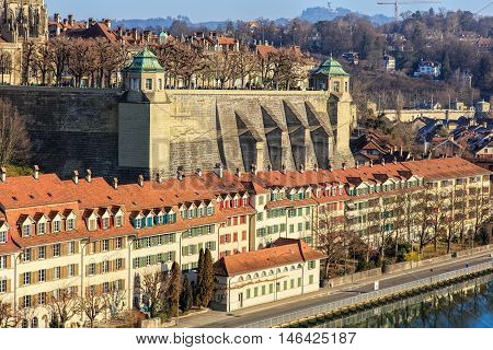 Bern, Switzerland - 29 December, 2015: buildings along the Aare river, wall of the Bern Minster. The city of Bern is the capital of Switzerland and the fourth most populous city in the country.