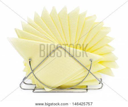 Table napkin holder with yellow napkins isolated on white background. Pile of napkins