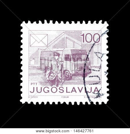 YUGOSLAVIA - CIRCA 1986 : Cancelled postage stamp printed by Yugoslavia, that shows Postman and mail van.