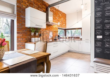 Spacious Kitchen With White Furniture