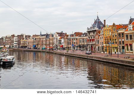 Haarlem, Netherlands - April 2, 2016: Picturesque landscape with beautiful traditional houses reflection in canal, Haarlem, Holland