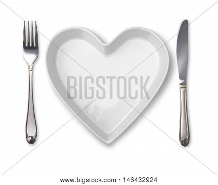plate in shape of heart table knife and fork isolated on white
