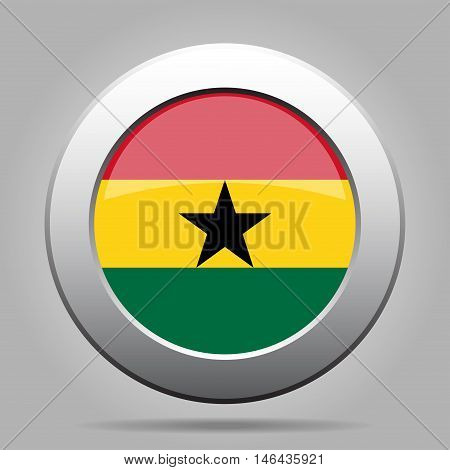 metal button with the national flag of Ghana on a gray background