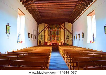 August 29, 2016 in Santa Fe, NM:  San Miguel Mission Chapel built between 1610 and 1626 with Spanish Colonial architectural design which is the oldest church in the United States and where people can worship today taken in Santa Fe, NM