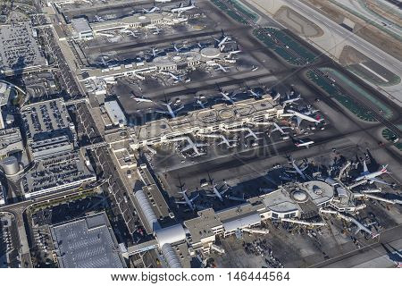 Los Angeles, California, USA - August 16, 2016:  Aerial view of busy LAX terminals and jet airplanes.