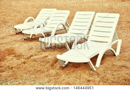 Beach chairs on the golden sand beach