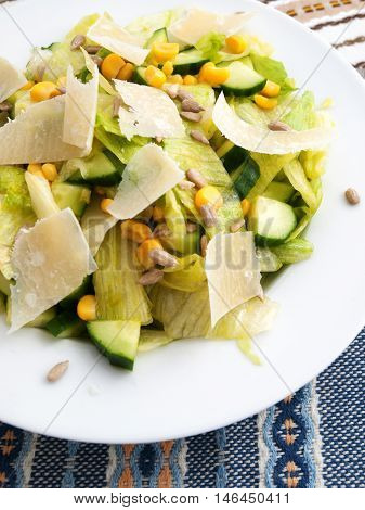 Healthy salad with cucumber sweetcorn and parmesan cheese