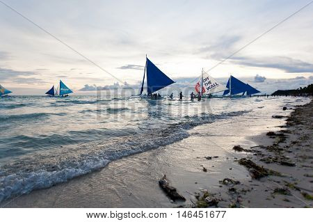 Sailing Boats At Boracay Sunset