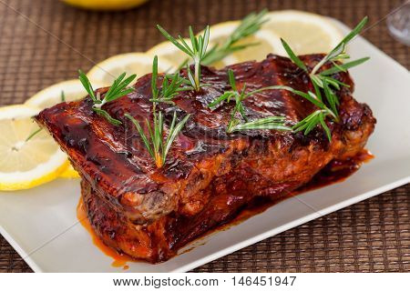 Slow cooked pork ribs with rosemary. Horizontal shot.
