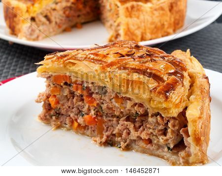 Homemade meat pie from ground beef and vegetables. Horizontal shot