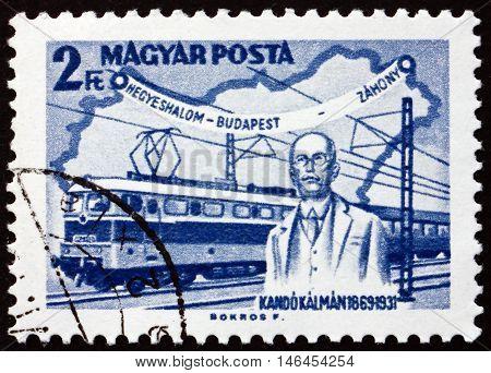 HUNGARY - CIRCA 1968: a stamp printed in Hungary shows Kando Statue Miskolc Kando Locomotive and Map of Hungary Kalman Kando Engineer and Inventor circa 1968