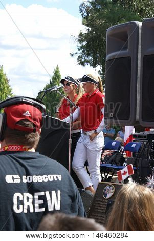 SMITHS FALLS ON CANADA SEPTEMBER 09 2016 - A 50 Editorial Image Series of local Pro Golf Sensations Brooke M. Henderson and her sister Brittany Henderson giving a speech in front of their Hometown of Smiths Falls shortly after the efforts in the Summer Ri